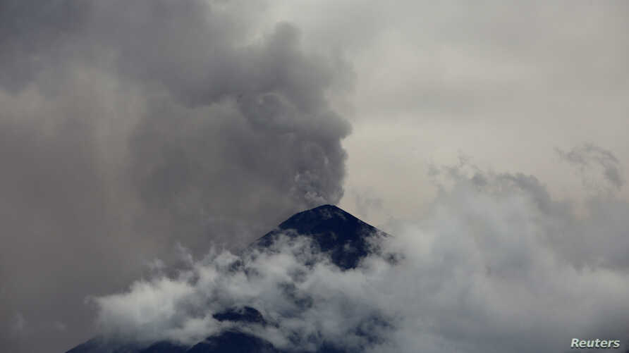 The Fuego volcano spews a cloud of steam and ash high into the air, as seen from Antigua, Guatemala, May 5, 2017.