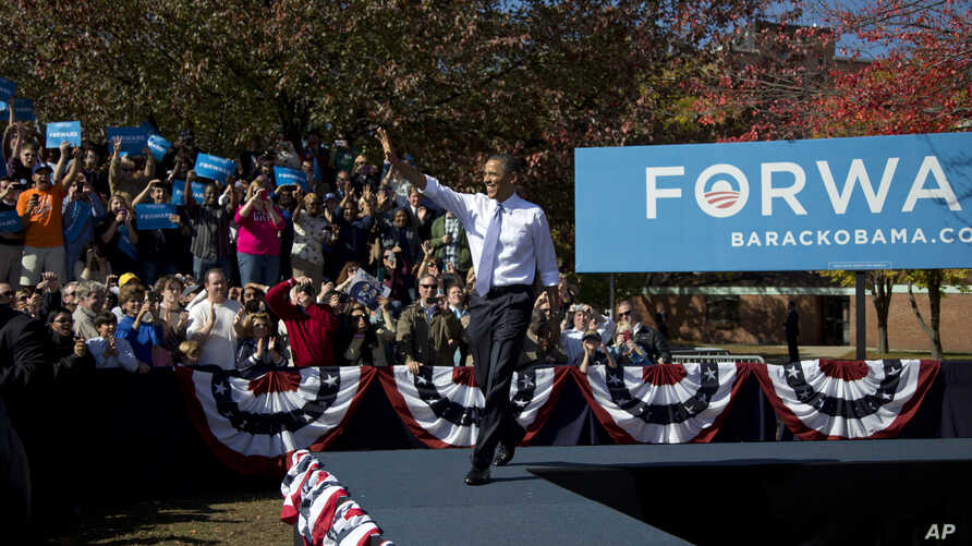 President Barack Obama arrives to speak at a campaign event at Veteran's Memorial Park in Manchester, New Hampshire, Oct. 18, 2012.