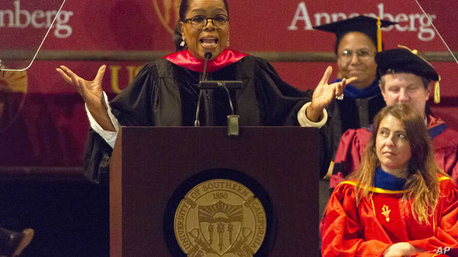 FILE - Oprah Winfrey speaks to graduates at USC's Annenberg School for Communication and Journalism at the Shrine Auditorium in Los Angeles, May 11, 2018.