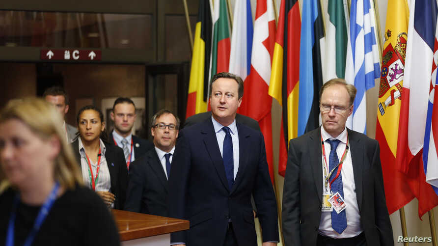 FILE - The U.K. ambassador to the European Union Ivan Rogers, right, walks with then-Prime Minister David Cameron as they leave the EU Summit in Brussels, Belgium, June 28, 2016.