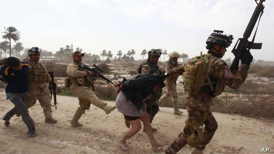 FILE - Iraqi security forces arrest suspected Islamic State militants in Jurf-al-Sakhar, 60 km (40 miles) from the capital Baghdad, Feb. 15, 2014.