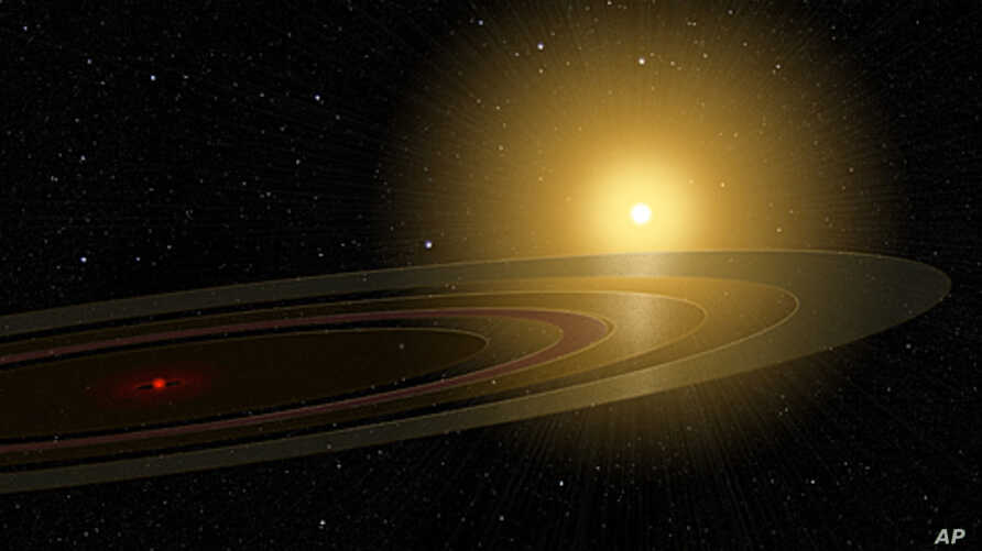 This illustration depicts the newly-discovered rings of dust and other cosmic debris that surround a mysterious object which orbits a relatively young, sun-like star in a system located 420 light years from Earth.