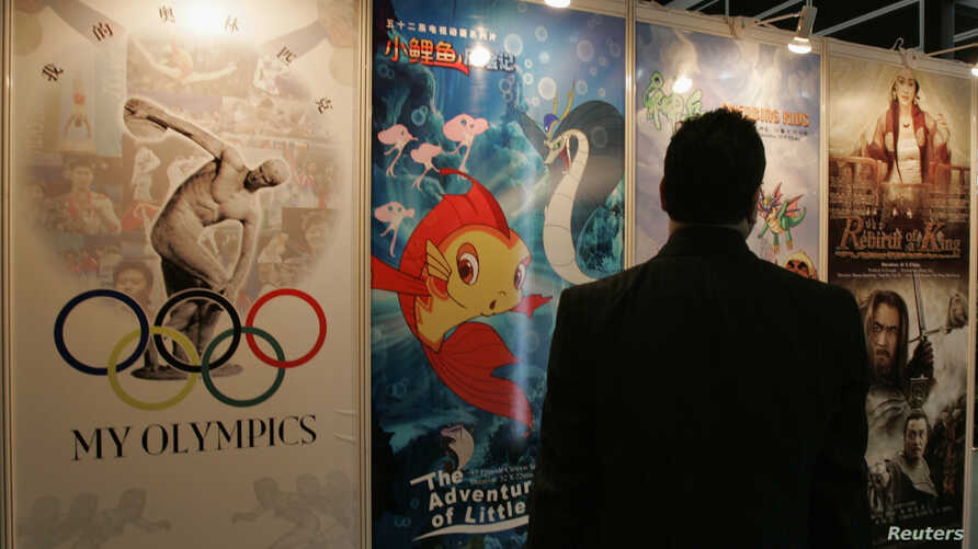 """A visitor looks at posters of productions of China International TV Corporation at """"Filmart,"""" a part of Entertainment Expo Hong Kong, in Hong Kong, March 20, 2007."""