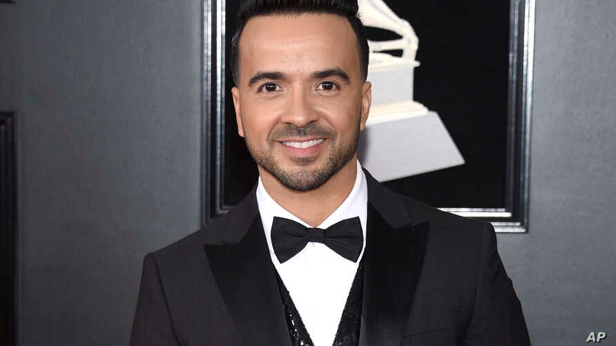 FILE - Luis Fonsi arrives at the 60th annual Grammy Awards in New York, Jan. 28, 2018.