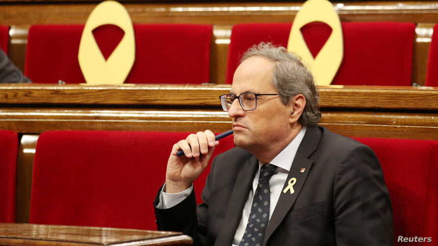 Catalan President Quim Torra attends a session vote on whether former Catalan President Carles Puigdemont and other members of his government can keep their seats as lawmakers while under investigation or in prison on charges of rebellion, at Catalon