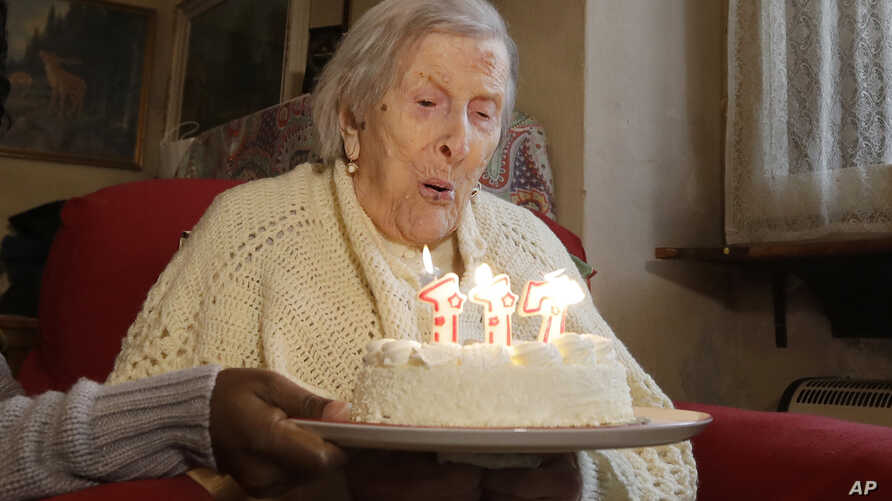Emma Morano, 117 years old, blows candles in the day of her birthday in Verbania, Italy, Nov. 29, 2016.