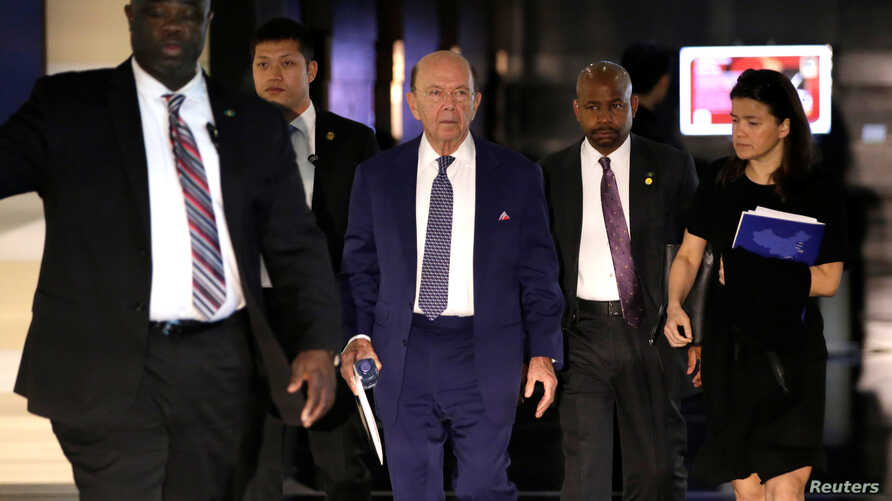 U.S. Commerce Secretary Wilbur Ross (C), a member of the U.S. trade delegation to China, leaves a hotel in Beijing, China, May 3, 2018.
