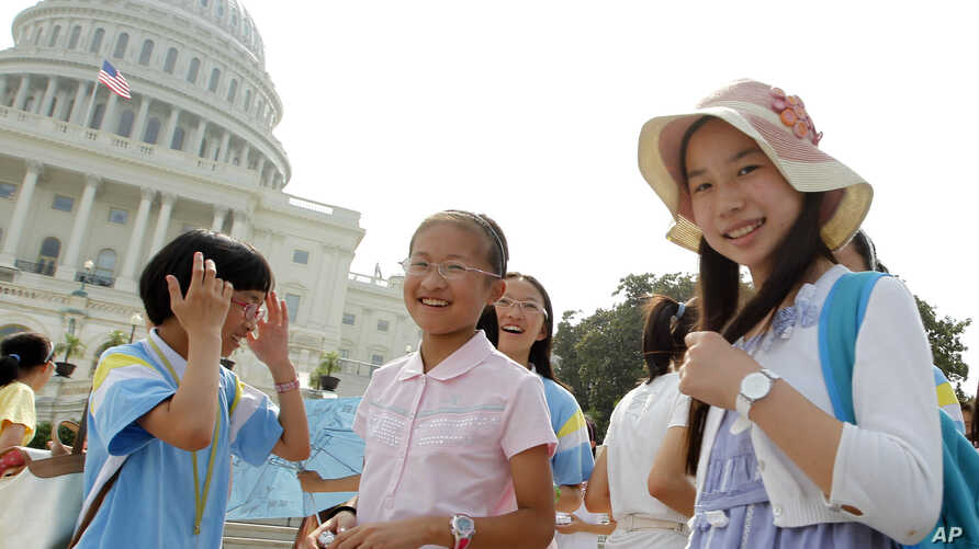 Chinese students from Hangzhou visit the U.S. Capitol in Washington as Congressional leaders try to reach a bipartisan accord to avert a debt-ceiling crisis, Sunday, July 24, 2011.