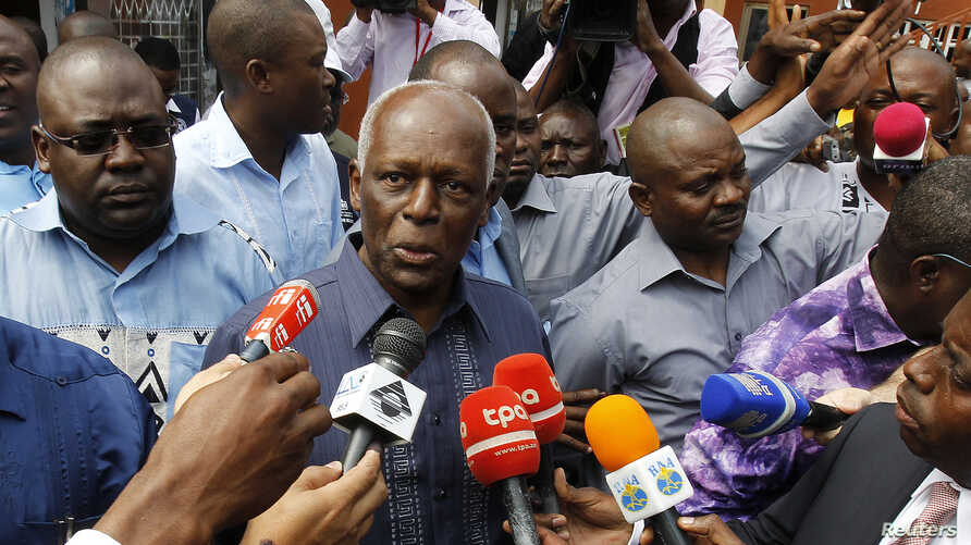 Angola's President Jose Eduardo dos Santos (C) addresses the media after casting his vote during national elections in the capital Luanda, August 31, 2012.