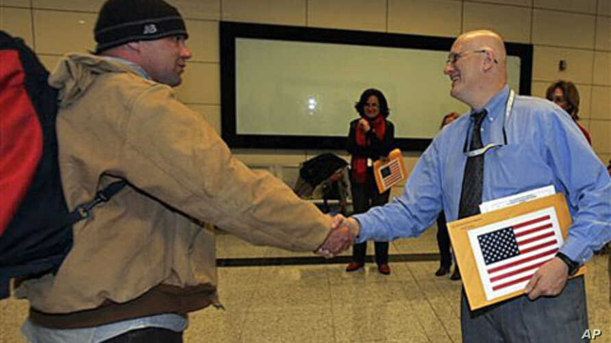 An American evacuee from Libya is welcomed by a U.S. embassy official, right, after his arrival at the Ataturk Airport in Istanbul, Turkey, February 25, 2011