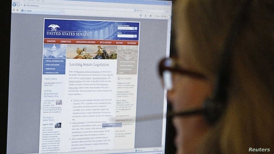 A journalist checks the U.S. Senate's website after it was attacked by hackers in Washington, June 13, 2011.