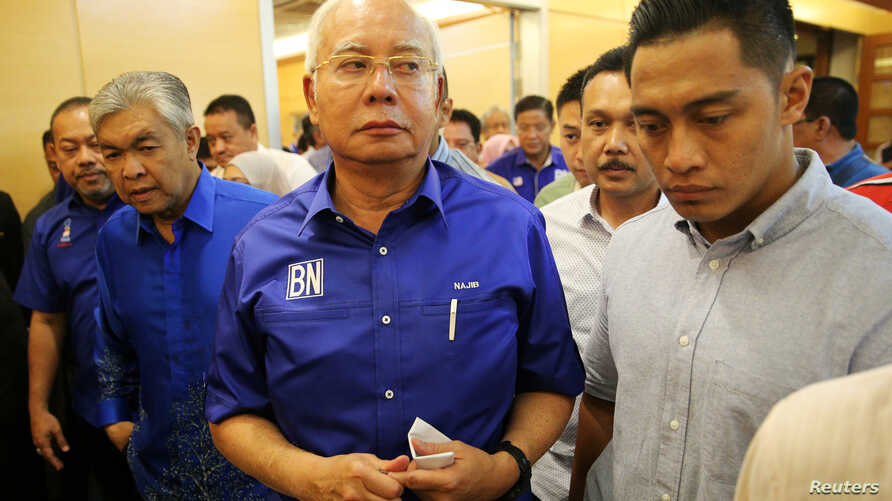 Malaysia's outgoing Prime Minister Najib Razak walks to a news conference to concede the general election in Kuala Lumpur, Malaysia, May 10, 2018.