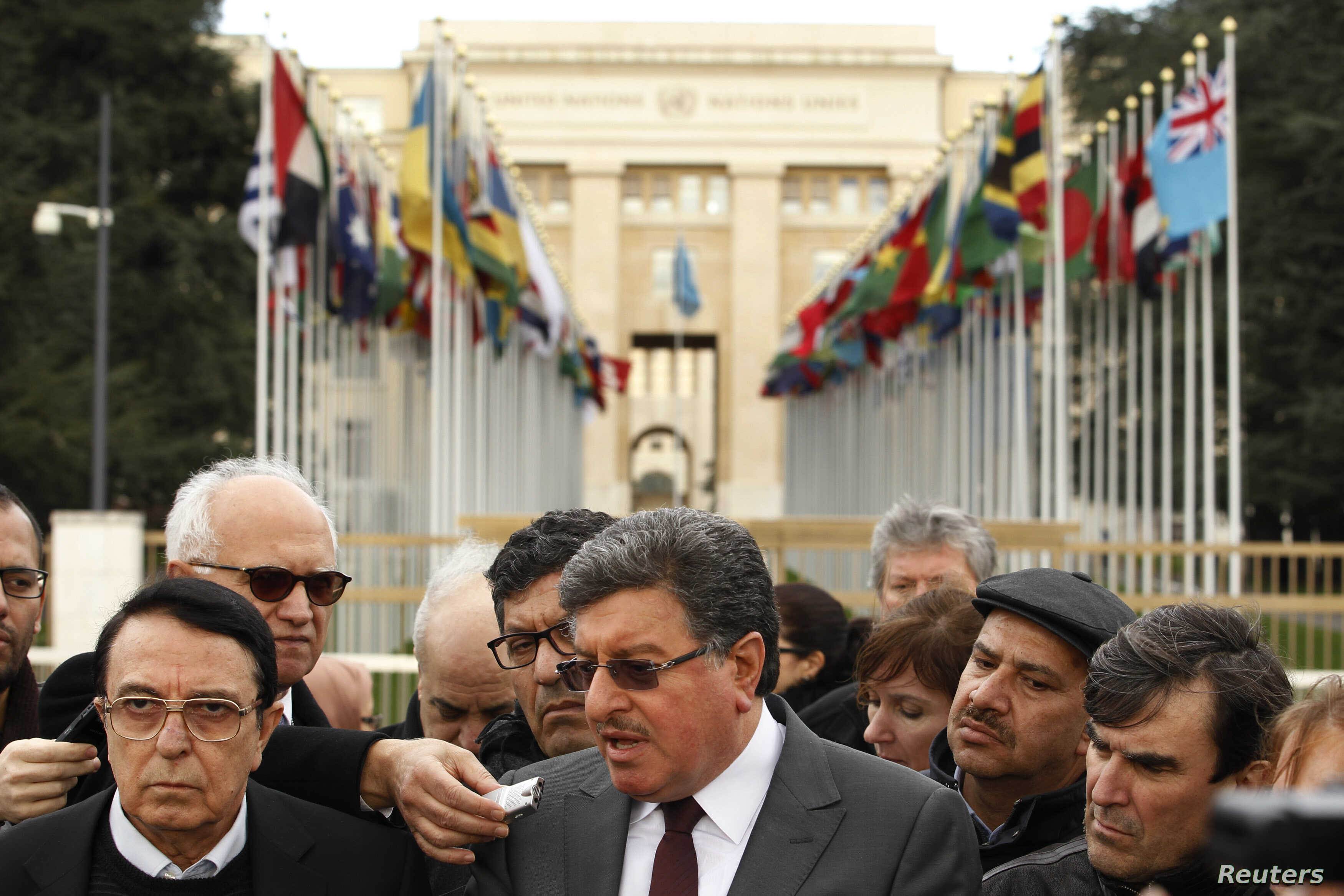 Salim al-Muslat (C) spokesman for the High Negotiations Committee (HNC) and Riad Naasam Agha, member of HNC deliver a statement during the Geneva Peace talks outside the United Nations in Geneva, Switzerland, Feb. 2, 2016.