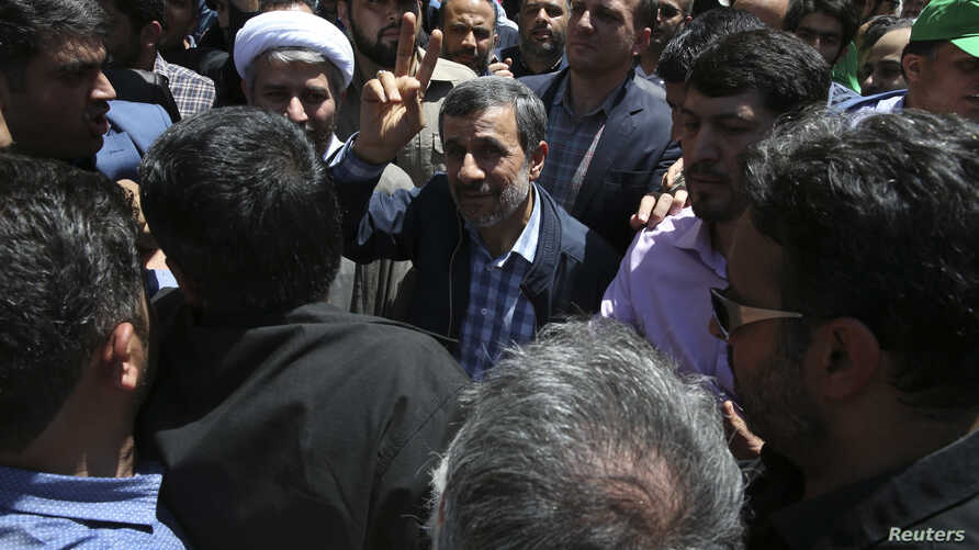 Former Iranian President Mahmoud Ahmadinejad (C) flashes a victory sign while attending the annual anti-Israeli Al-Quds, Jerusalem, Day rally in Tehran, Iran, June 8, 2018.