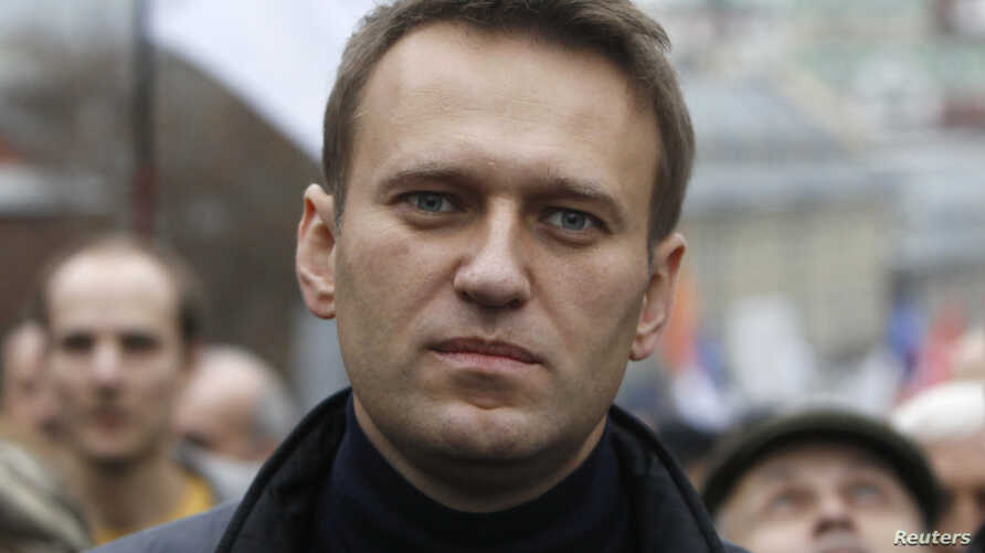 Russian opposition leader Alexei Navalny walks during an opposition rally in Moscow, Oct. 27, 2013.