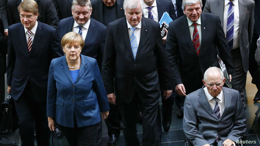 Members of Germany's conservative parties arrive for preliminary coalition with the Social Democratic Party at the Parliamentary Society in Berlin, Oct. 14, 2013.