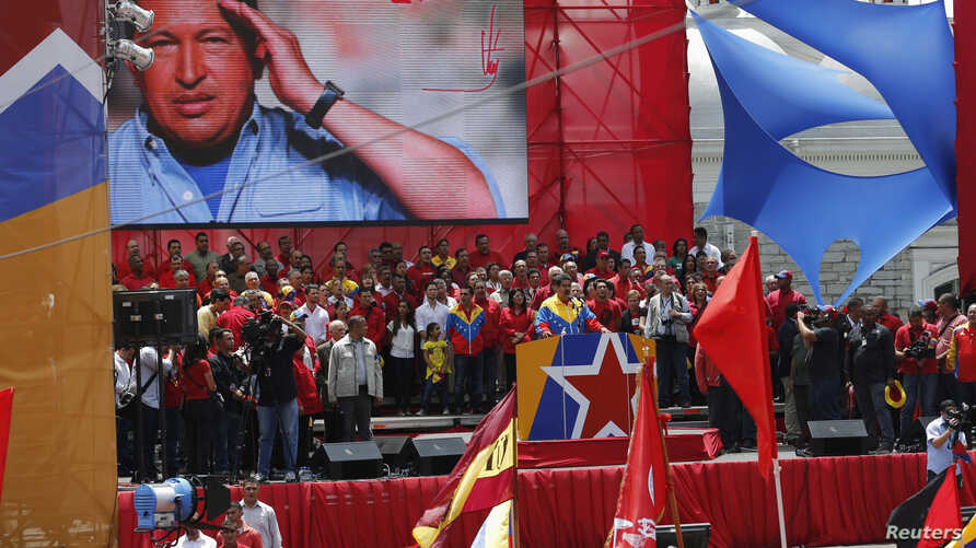 Venezuela's acting President Nicolas Maduro (C) talks to supporters after registering as a candidate for president in the April 14 election outside the national election board in Caracas on March 11, 2013.