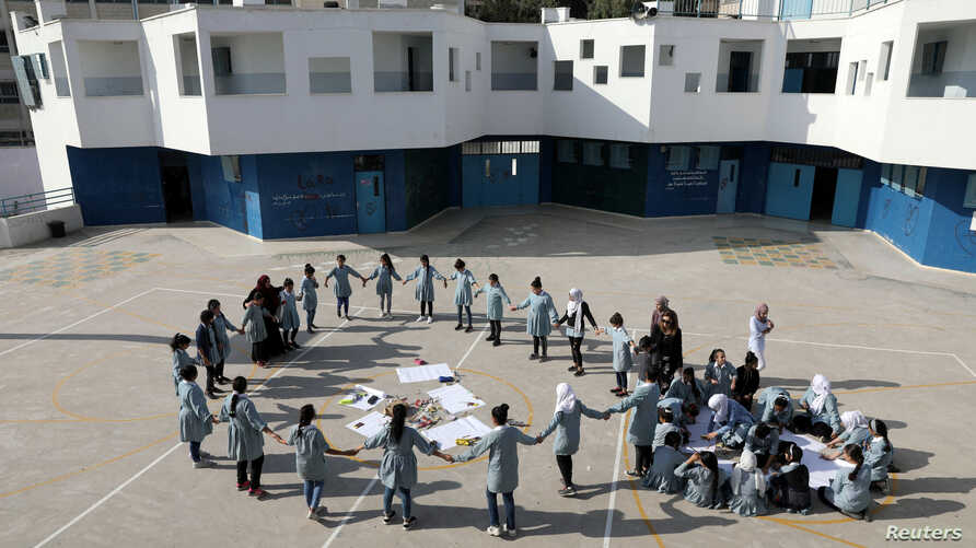 FILE - Palestinian children take part in an activity at a school run by United Nations Relief and Works Agency in the Shuafat refugee camp in East Jerusalem October 10, 2018.