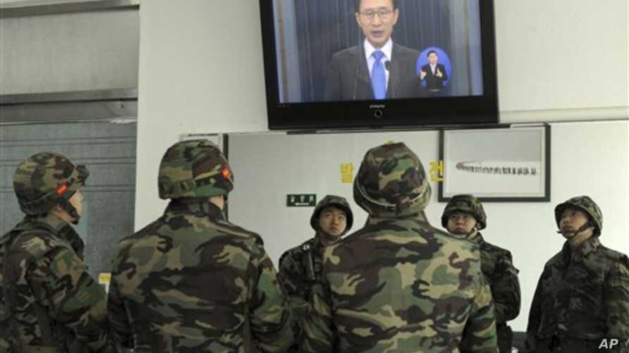 South Korean marines watch a live television broadcast of President Lee Myung-bak's speech, on Yeonpyeong Island, South Korea, Monday, Nov. 29, 2010. Lee took responsibility for failing to protect his citizens from a deadly North Korean artillery att