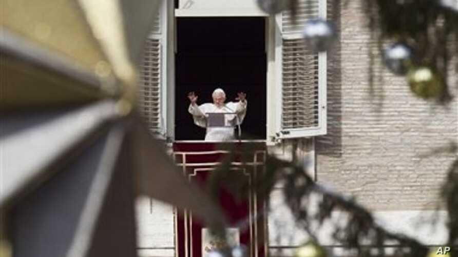 Pope Benedict XVI delivers his blessing during the Angelus noon prayer he celebrated from the window of his studio overlooking St. Peter's square at the Vatican, 26 Dec 2010.