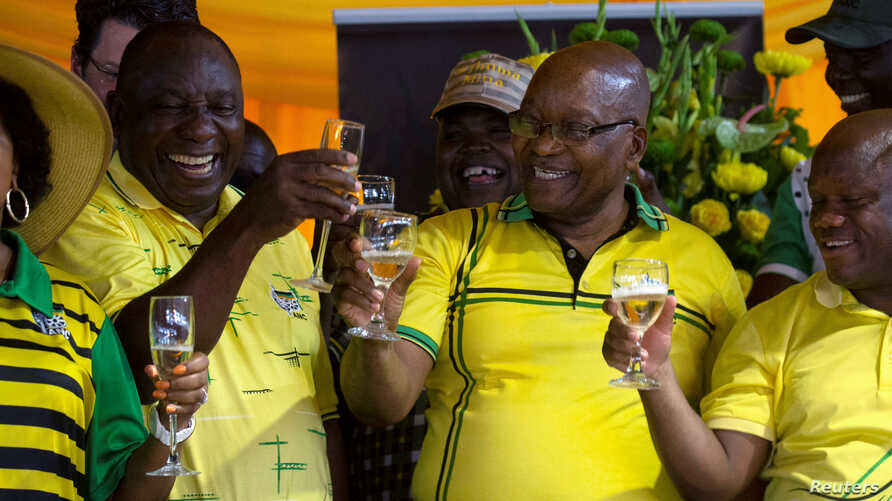 South African President Cyril Ramaphosa and former president Jacob Zuma celebrate the 107th anniversary of the African National Congress, in Durban, South Africa, Jan. 8, 2019.