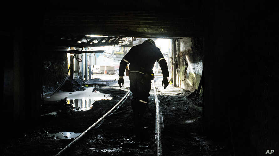 FILE - A miner walks out of a coal mine in Yukon, W.Va.
