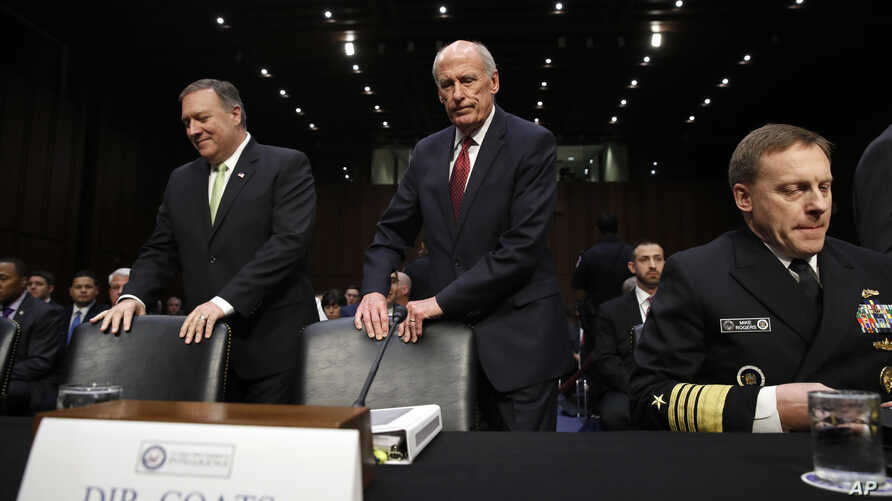 From left, CIA Director Mike Pompeo, Director of National Intelligence Dan Coats, and National Security Agency Director Adm. Michael Rogers take their seats on Capitol Hill in Washington, May 11, 2017.
