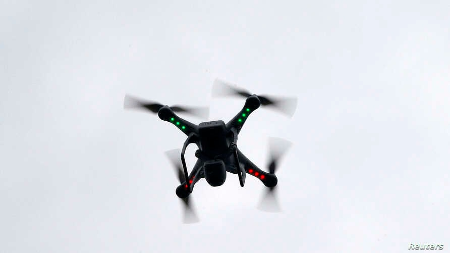 A camera drone flown by Brian Wilson flies near the scene where two buildings were destroyed in an explosion, in the East Harlem section in New York City, March 12, 2014.