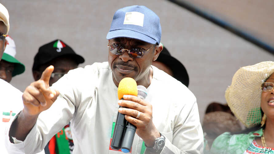 People's Democratic Party (PDP) governorship aspirant Charles Airhiavbere speaks during a political rally at Sabongida Ora in Edo State June 13, 2012.