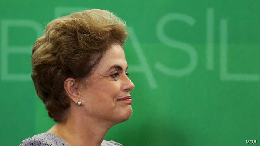 Brazil's President Dilma Rousseff smiles as she attends a meeting with jurists at Planalto Palace in Brasilia, Brazil, March 22, 2016.