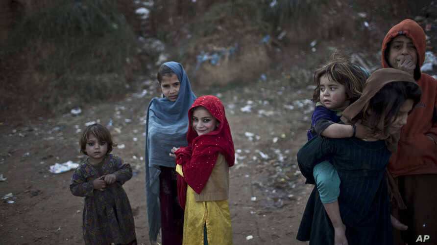 Afghan refugee children are seen in a slum on the outskirts of Islamabad, Pakistan, Jan. 14, 2015.