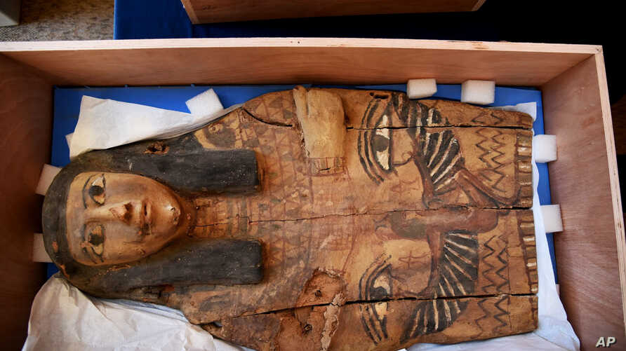 FILE - This undated photo released by the Israeli Foreign Ministry shows a part of an Egyptian sarcophagus cover in Israel. Israeli officials discovered the item in 2012 in an antique dealer's store in Jerusalem's Old City.