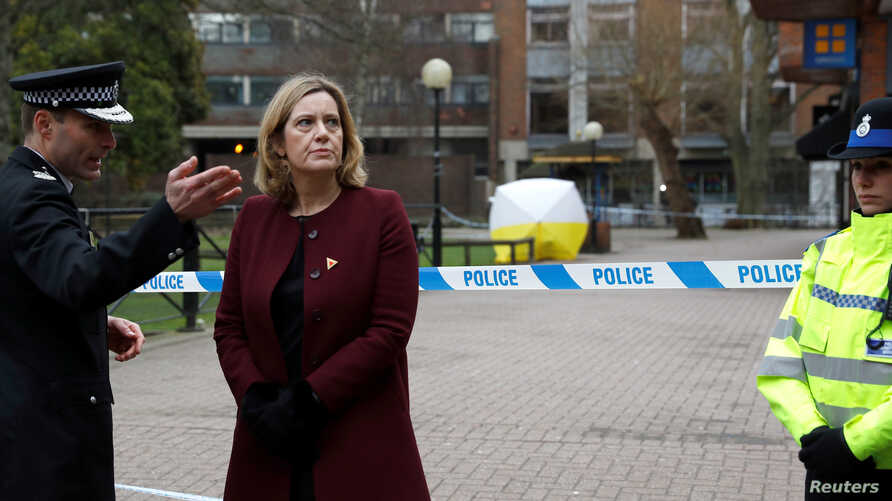 Britain's Home Secretary Amber Rudd visits the scene where Sergei Skripal and his daughter Yulia were found after having been poisoned by a nerve agent in Salisbury, Britain, March 9, 2018.