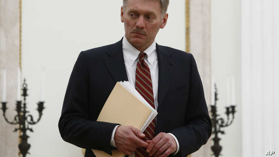 FILE - Russian President Vladimir Putin's spokesman Dmitry Peskov is seen at the Kremlin in Moscow, Russia, March 27, 2017.