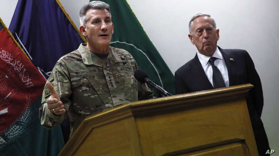 U.S. Defense Secretary James Mattis, right, and U.S. Army General John Nicholson, left, commander of U.S. Forces Afghanistan, hold a news conference at Resolute Support headquarters in Kabul, Afghanistan, April 24, 2017.