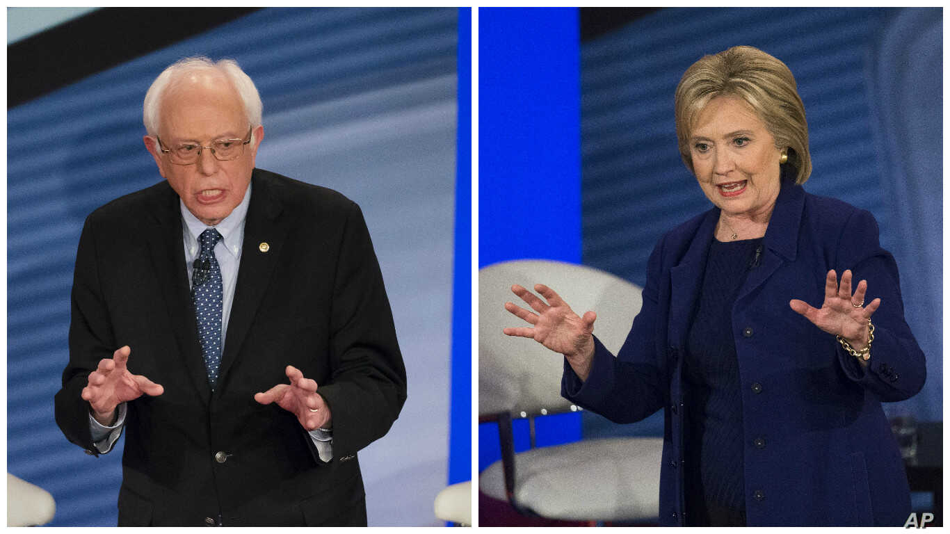 Democratic presidential candidate Senator Bernie Sanders, left, and former Secretary of State Hillary Clinton participate in town hall event in Derry, New Hampshire, Feb. 3, 2016.