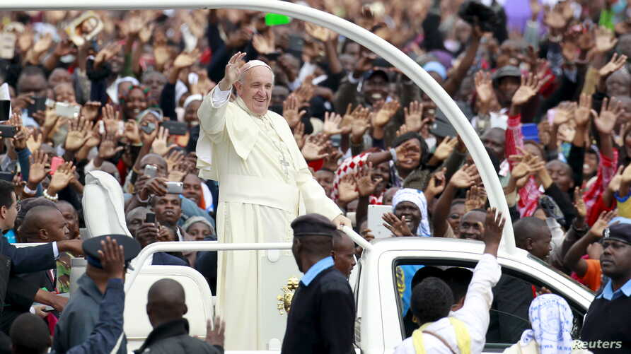 Pope Francis waves to the faithful as he arrives for a Papal mass in Kenya's capital Nairobi, Nov. 26, 2015.
