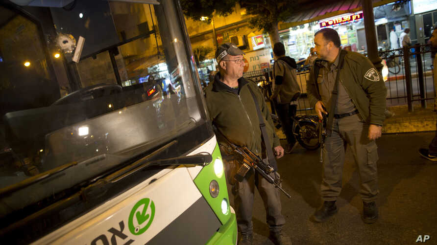 A bullet hole is seen on the windshield of a bus at the scene of a shooting attack in Petah Tikva, Israel, Feb. 9, 2017.