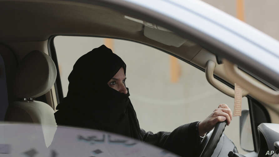 SauFILE - Aziza Yousef drives a car on a highway in Riyadh, Saudi Arabia, March 29, 2014, as part of a campaign to defy Saudi Arabia's ban on women driving. Carmakers hoping to sell more cars in Saudi Arabia are applauding the king's order to draw up...