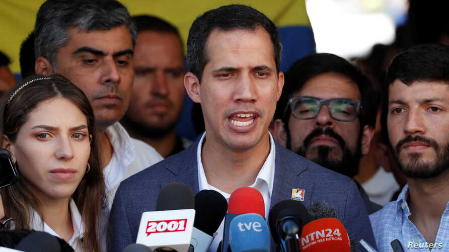 Venezuelan opposition leader Juan Guaido, whom a number of nations have recognized as the country's rightful interim president, talks to the media after attending a religious service in Caracas, Venezuela, Feb. 10, 2019.