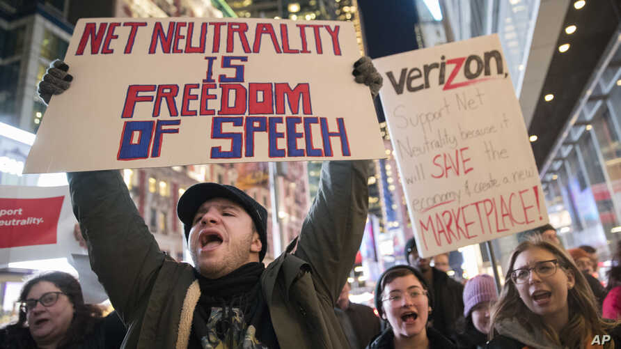 Demonstrators rally in support of net neutrality outside a Verizon store, Dec. 7, 2017, in New York.