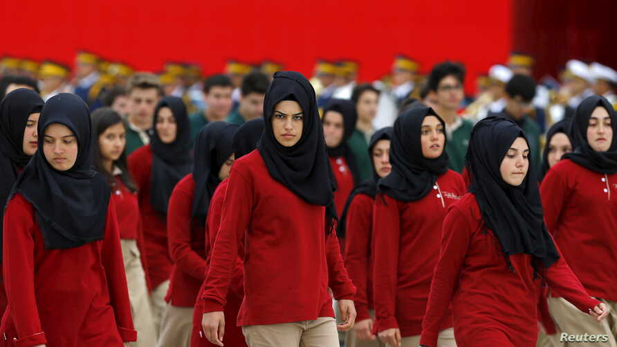 FILE - Students of an Imam Hatip high school march during a Republic Day ceremony in Ankara, Turkey.