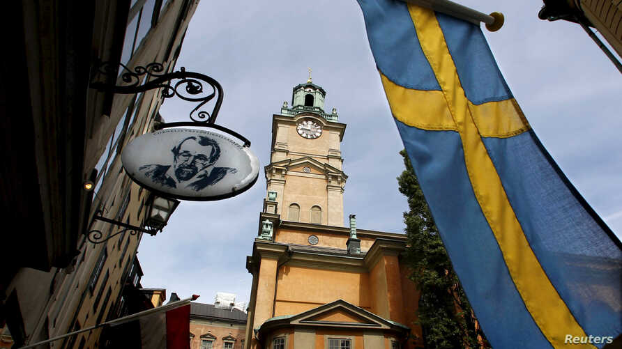 FILE - Sweden's flag is seen near the Stockholm Cathedral in Gamla Stan or the Old Town district of Stockholm, Sweden.