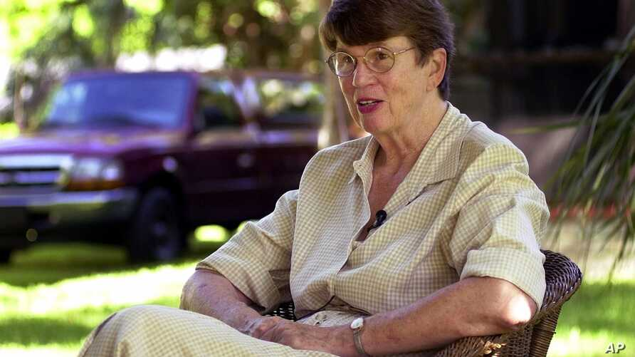 FILE - In this 2001 photo, former U.S. Attorney General Janet Reno speaks to the media at her Miami home after announcing that she would be running for Governor of Florida.