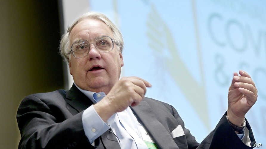 FILE - Philanthropist Howard G. Buffett, son of investor Warren Buffett, participates in a panel discussion at the conference on cover crops and soil health, in Omaha, Neb., Feb. 2014