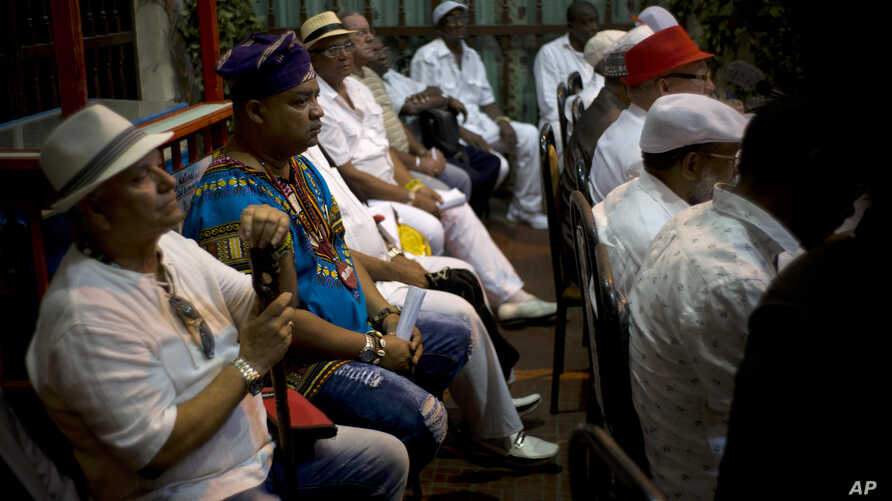 Santeria priests attend the reading of the annual Letter of the Year, written by Afro-Cuban Santeria priests, listing predictions for the new year in Havana, Cuba, Jan. 3, 2017.