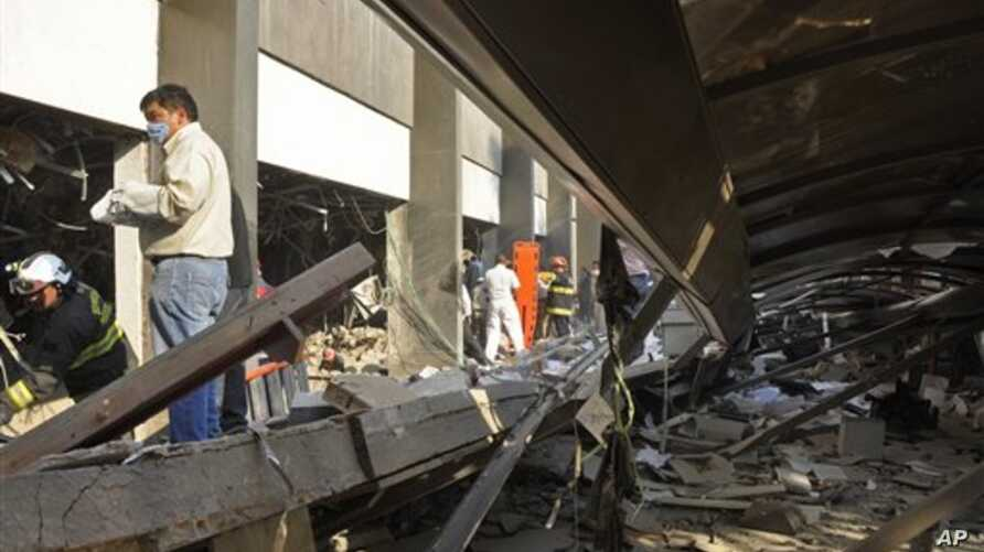 Firefighters dig for survivors after explosion near headquarter's of Mexico's state-owned oil company PEMEX, in Mexico City, Jan. 31, 2013