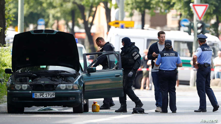 Police specialists looks into a car in Berlin, Germany, May 29, 2017.