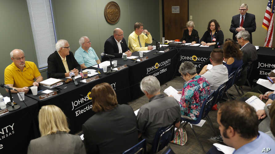 Johnson County chief council Don Jarrett speaks during the Johnson County Board of Canvassers meeting, Aug. 13, 2018, in Olathe, Kansas.