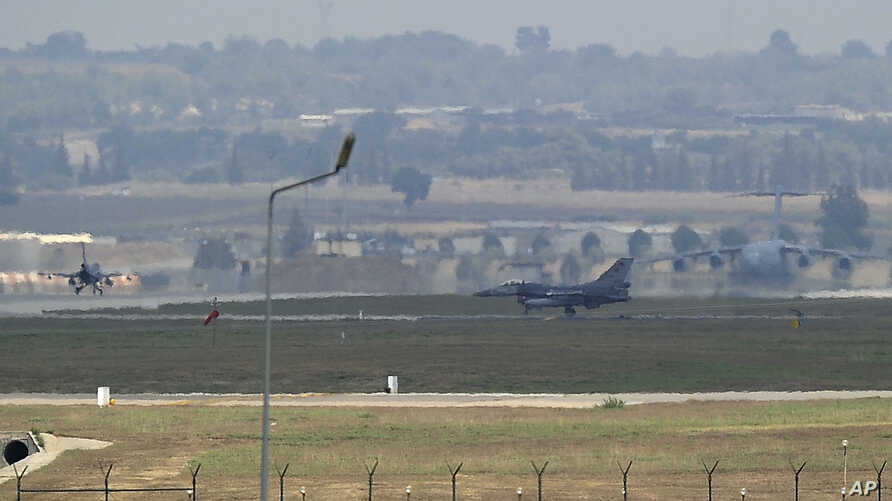 FILE - Turkish Air Force fighter planes maneuver on the runway at the Incirlik Air Base, in Adana, southern Turkey, Aug. 13, 2015.